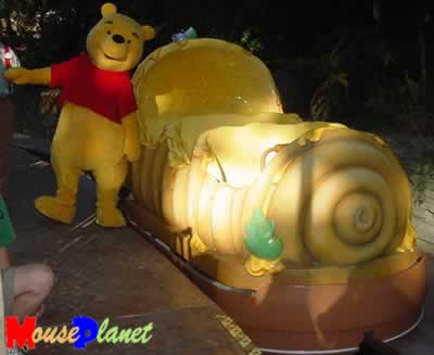 Photograph of Winnie the Pooh with new ride vehicle