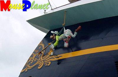 Crewmember Goofy is busy touching up the Magic.