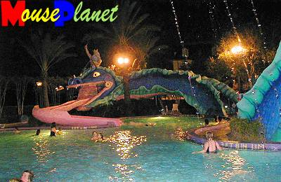 Doubloon Lagoon's sea serpent at night.